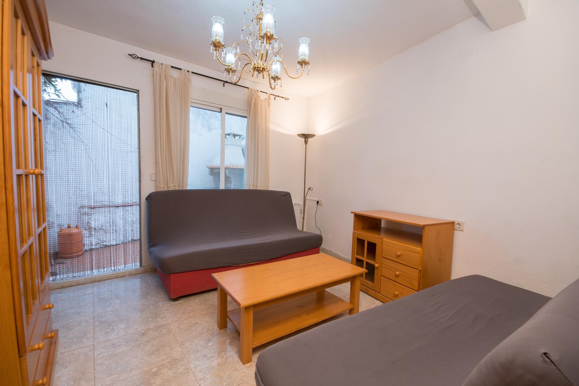 Caudiel - Casa Maestro - Salón Sofá cama y terraza barbacoa